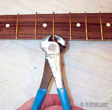 cutting fret hangover with end cutting nippers