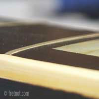 frets that are nearly flush with the fingerboard