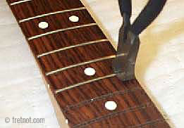 Edge strip fret markers on bass guitar all